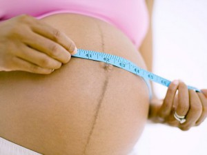 Темная полоска на животе во время беременности